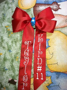 Machine embroidery tails down cheer bow