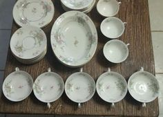 """Haviland Apple Blossom. 5 Cream Soups - one with a handle broken off, 6 Cream Soup Saucers, 8 Coffee Cups, 8 Saucers, 8 10¼"""" Dinner Plates, 2 Serving Bowls... one is the oval veggie bowl as shown, not sure what the other is. Then it lists the last items as 2 regular saucers... ?? Bid starting at $20.00 at taffyoka30 on ebay, 2/2/16"""