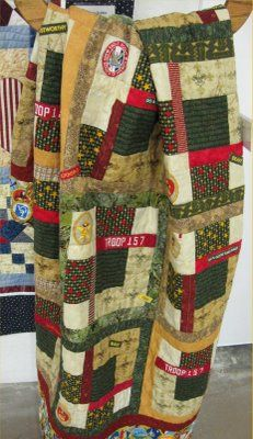 A beautiful Eagle Scout quilt; wish it was displayed better.
