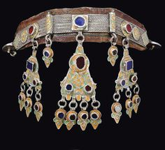 Morocco | Headdress; silver with glass insets, enamel, on a leather brand | ca. 19th century, Anti Atlas region | Sold