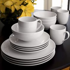 Crisp white oversized coupe shape in durable porcelain goes casual for everyday, or sophisticated for formal dinners.