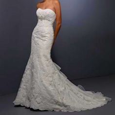 My wedding dress! Minus that ruffle in the back. Private label by G is the designer style # 1437