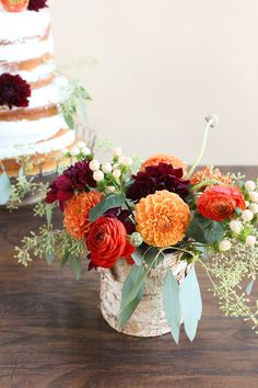 For a classic fall wedding, there's nothing quite like a color scheme of burgundy, orange, and olive — the same colors as the season's infamous, transforming