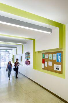 Modern mid-century Los Angeles school reuse bright hallway.