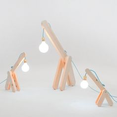 A family of table lamps styled like long-necked animals