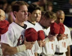 Houston Astros' Craig Biggio, left, gets emotional during a moment of silence for former teammate and friend St. Louis Cardinals' Darryl Kile before the game against the Seattle Mariners Saturday, June 22, 2002, in Houston. Beside Biggio are Brad Ausmus, center, and Jeff Bagwell. None of the three were in the starting lineup for the game.