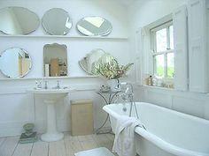 nice! victorian bath & basin, vintage mirrors... all white