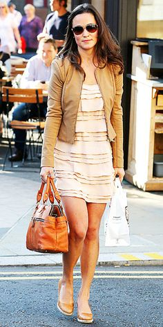 September 28, 2011  Pippa worked a blush tiered silk French Connection Penny's Party Dress with her Pippa Modalu bag and a tan Whistles jacket for a London outing.