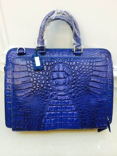 Men's genuine crocodile skin carrying bag with available slots for laptop or tablet and cellphone. $1190