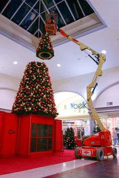 Putting the top on the #Christmas tree at Columbiana Mall in Columbia, SC.
