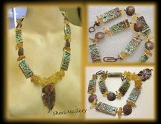 by Sheri Mallery my porcelain pottery shards with fold formed domed copper patina'd discs and amber chunks.