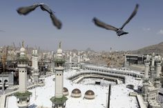 Oct. 19, 2012. Pigeons fly over the Grand Mosque at Friday prayers during the annual haj pilgrimage in the holy city of Mecca, Saudi Arabia.