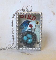 Soldered Shadowbox Pendant Necklace with 3-D Birdnest and Original Collaged Images. $42.00, via Etsy.