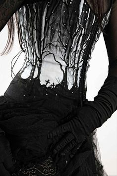 Love the overlay on the corset, by Wolf Clothing.
