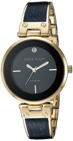 2933e3d3e89 Anne Klein Women s Diamond-Accented Gold-Tone and Navy Blue Marbleized  Bangle Watch