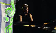 girl playing piano,  music motif -  treble clef