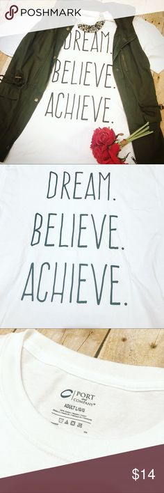 NEW Dream Believe Achieve Inspiration Graphic Tee New without tags. Only one available, so snag it before it's gone! Graphics are imprinted into the cotton, so it won't crack. Unisex fit tee. White with black graphics. Reasonable offers accepted via offer button only. (No offers on items less than $10, please, due to posh fees.) No trades. I strive to maintain good feedback. I'm a real person. If for any reason you are unhappy with your purchase, please contact me. Coffee Bean's Boutique…
