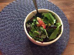 Dinner on the Folsom, California farm. Organic spring greens, peas, tomato, banana, pecan medjool dates, and avocado. Yummy