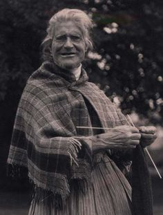 Elderly patient knitting in Hospital Grounds.