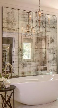A marvelous idea to use mirror tiles as decoration