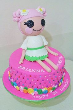 minus the creepy doll, and adding the big button on top.Together with the cup cakes maybe?
