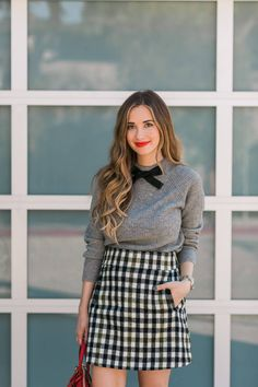 gray bow sweater with tweed skirt
