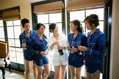 bride with bridesmaids in blue silk pajamas toasting bride at trump national…