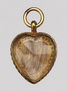 1706 Boston, Hair, Gold, Crystal Locket.. The earliest jewelry made and owned in America was of a sentimental nature, related either to courtship and marriage or to death and mourning. Rings were often presented at funerals to relatives and close friends of the deceased. Human hair and symbols of death were sometimes incorporated into mourning jewelry.