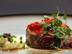 Get Bison Tenderloin with Piquillo Pepper Pesto and Tapenade Mashed Potatoes Recipe from Food Network