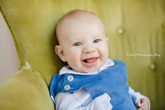 Baby Boy's photoshoot indoor studio photo session! Green chairs make for the best prop! look at those blue eyes!