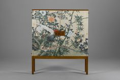 Josef Frank Cabinet Mahogany, adjustable shelves. Doors and sides lined with hand-painted paper. ca 1950