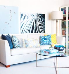 There's something about the white walls, floor, and couch with the bold pillows that I really like.