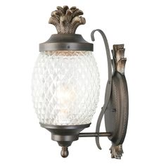 Get on the pineapple trend with a stylish outdoor light. A decorative exterior pineapple light extends a warm welcome to guests.