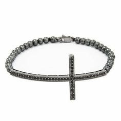 Sterling Silver Oxidized CZ Sideways Cross Bracelet Eve's Addiction. $58.00. Approximate Weight: 7.5 grams. TCW: .35 carats. Charm Size: 2.5 inches
