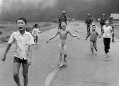 Kim Phuc, pictured above,  was running from an airborne attack, horribly burned with napalm, in June of 1972, 40 years ago this month. She ran blindly, in unbelievable pain, right at the lens of Associated Press photog Nick Ut. I don't know what his shutter speed was. 1/125th? 1/250th? The blink of an eye. The click of a shutter. And this young girl ran into the pages of history.