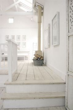 love this top of the stairs..sky lights, white washed wood floor..nicely done