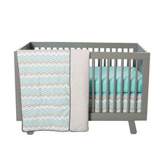 Trend Lab can bring a calm contemporary feeling to your nursery with the Seashore Waves collection. Trend Lab's Seashore Waves 3 Piece Crib Bedding Collection features fashionable chevron stripes are printed onto a refreshingly clean white background in the serene color palette of aqua sky mixed with dove and neutral grays.<br><br>Reversible quilt measures 35 in x 45 in and features a charming chevron stripe in aqua sky with shades of gray and crisp white. Quilt is backed in a dove gray and…