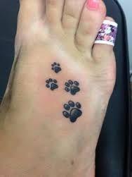 Leuke tattoo hondenpootje
