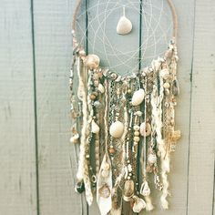 White Sea Dreamcatcher is perfect to use for an event decoration, and then hang inside your home afterwards. Adorned with ocean treasures, This piece is a great fit for bringing together an ocean themed party, wedding, or decorating theme. 12 x 20 Some of our favorite moments: -pink sea urchin shell -boho lace -detailed driftwood *Everything is hand created :) We want to share our love for the ocean with you by creating sculptural art that represents the oceans beauty. Everything is…