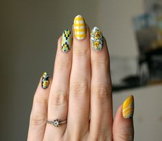 These sunny yellow nails are bound to brighten even the gloomiest day. #nails #nailart