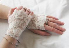Wedding gloves in an Ivory Short Lace fingerless Glove with gorgeous delicate floral and fern embroidery scattered across and on the edges. The leaf design and mesh background look very Victorian.