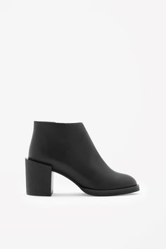 A clean, modern style, these ankle boots are made from moulded leather and have a chunky offeset wooden heel. Fastening with a metal side zip, they have a leather insole for comfort.