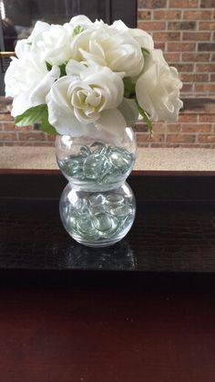 Easy Dollar tree craft: glass vases, fillers, flowers, hot glue