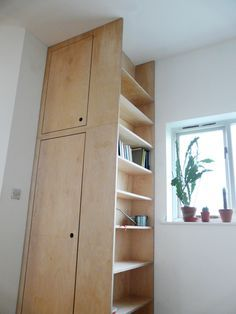 birch plywood shelving with integrated utility cupboard