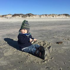 This kid loves the beach and clearly doesn't care that it's December. #beachbaby #beachlife