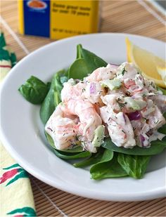 Shrimp Salad  1 Tbsp + 1 tsp kosher salt  juice of 1/2 lemon  1 pound large shrimp in the shell (16 to 20 shrimp per pound)  1/2 cup good mayonnaise  1 teaspoon Dijon mustard  1/2 teaspoon freshly ground black pepper  1/2 teaspoon Old Bay  2 tablespoons minced fresh dill  1/3 cup minced red onion  1/2 cups minced celery (1 stalk)