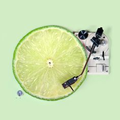 """LemonDJ - Paul Fuentes Design. In the world of Paul Fuentes, a lime slice is a spinning record, 'Pop-Tart' could be Pantone's colour of the year, and a banana is a lethal weapon. The Mexican visual artist's surreal """"pop mashups"""" invite viewers to see their food in a whole new way."""