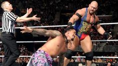 The Usos collide with Ryback & Curtis Axel in tag team action.