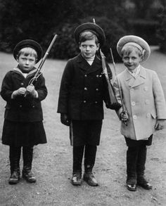 Crown Prince Olav of Norway (right) playing soldier with his maternal 1st cousins Prince John (left) and Prince George (middle) of York.