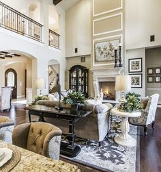 Gorgeous family room right off the entry in this Castle Rock, Colorado home. Dark stained hardwood throughout and beautiful white casings #DRHorton #FindYourHome